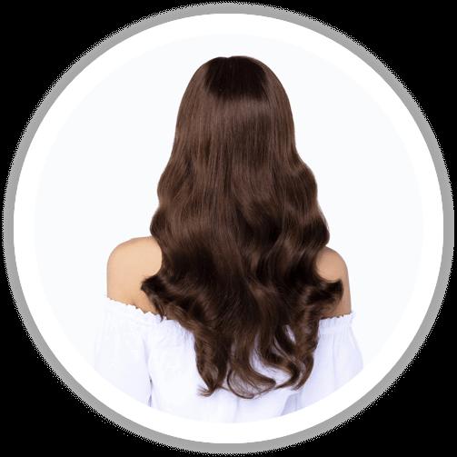 Dark brown, long and wavy human hair wig from behind